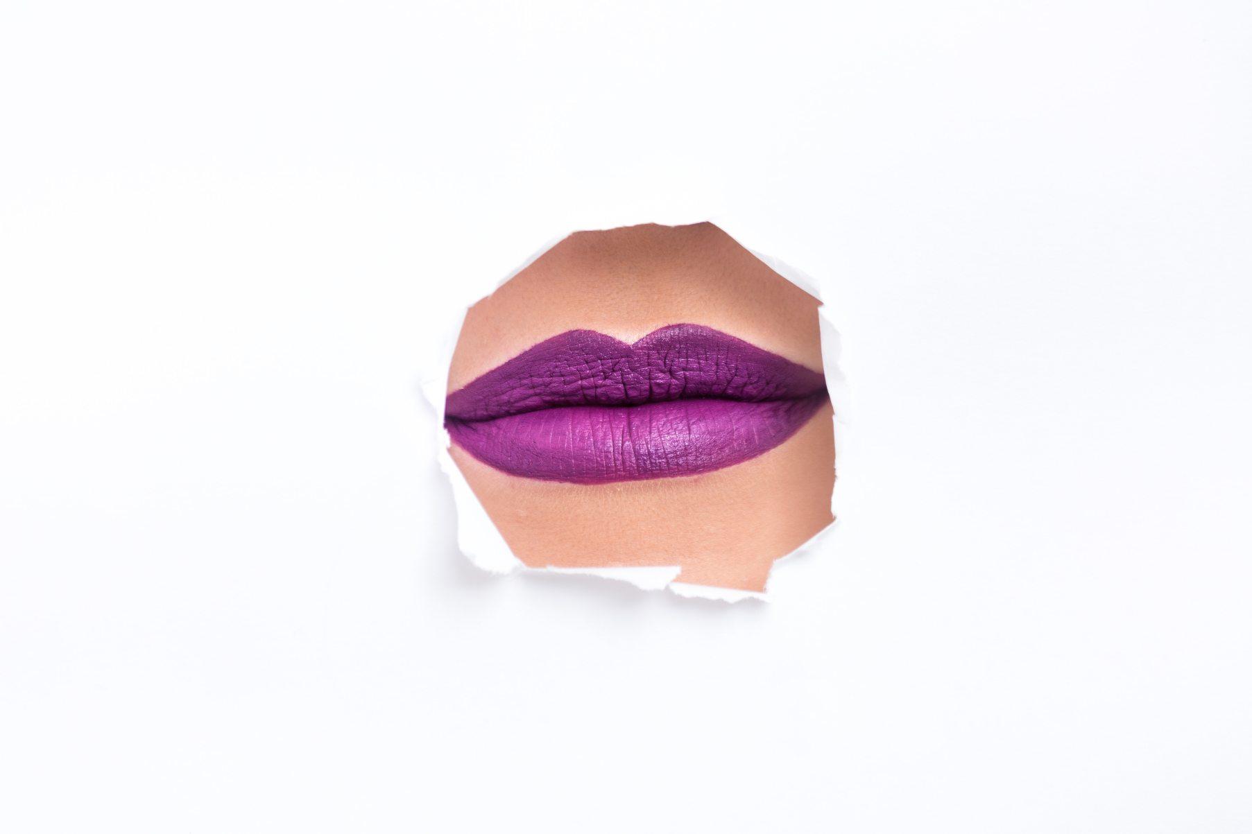 Lips with purple lipstick