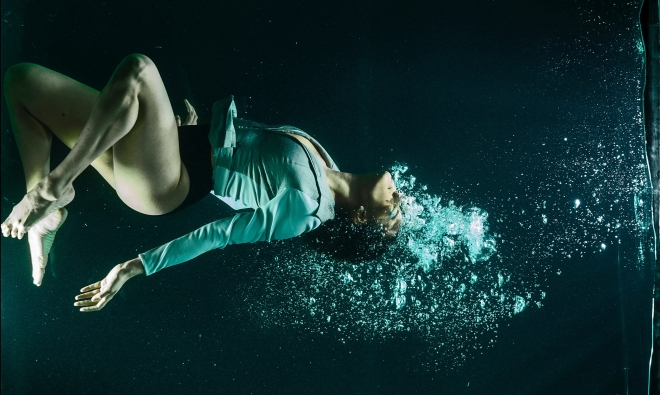 Woman surrounded by bubbles underwater